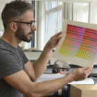 Man looking at color document after it's printed